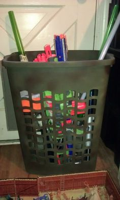 Keep big toys together by putting them in a plastic hamper--- 25 Totally Clever Toy Storage Tips and Tricks