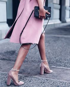 The Details - This image captures shoes, a handbag and a slit in a coat which are all beautiful details of an outfit.