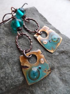These earrings are reserved for Nova. Please do not purchase unless you are Nova, but feel free to inquire about your own custom order. Thanks! (12/29) Gorgeous enameled copper charms, handcrafted by Marlene Kazor Quigley, are perfectly paired together with lampwork beads, handcrafted by Uta Karen Hammelmann, as well as twisted copper oval rings, handcrafted by Jill Eden. Wire wrapped in solid oxidized copper wire and suspended from copper earwires, these earrings measure about 2 1/...