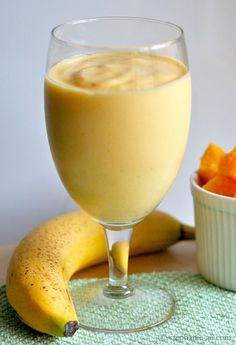 Mango smoothie  1 Cup of frozen mango, cut into small chunks  1 Cup of frozen pineapple, cut into small chunks  3/4 of a ripe banana (just munch on the 1/4 left as you are prepping your smoothie!)  2/3 cup Greek yogurt  1 1/2 Cup of orange juice