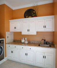 Home Design. Ikea Inspired Design Loundry Room. White Theme Interior Luxurious Laundry Room With Kitchen Space Ideas With White Painted Kitchen Set Cabinetry With Classic Pattern Sink And Orange Wall Paint Color Laundry Room Remodeling Ideas