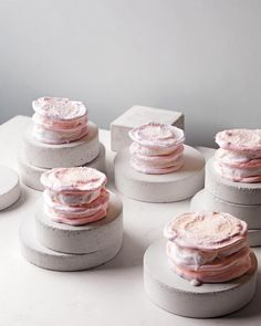 Coconut Meringue Cakes  Crisp-chewy baked meringues meet cool, creamy coconut sorbet in these blushing beauties.