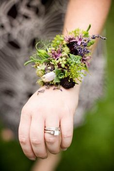 organic nature inspired corsage with lavender, dill, small succulents, berries, seedpods, pineapple blossoms and scabiosa buds - I love this, but would hope for more of a bluey shade than a purple.  So natural and detailed though