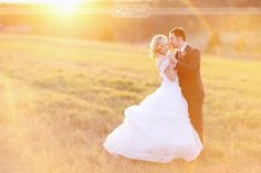 I think this photo sums up what everyone hopes for on their wedding day.    Romance, perfect light — there's even a rainbow, for goodness sake.
