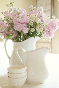 Maybe on dresser: Spring flowers in a white jug