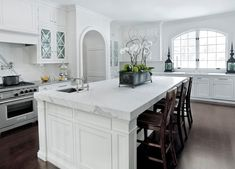 A white kitchen looks crisp and clean, while accents of chic black and stainless give it a modern twist Via Caden Design