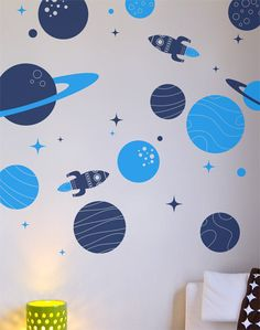 Wall decals children vinyl stickers - Pack of 11 Planets  with stars and two FREE rockets. $54.00, via Etsy.