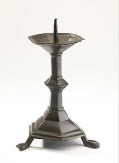 candlestick 1300-1400 Dimensions h. 16.5 cm Material and technique brass