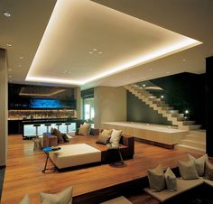 Luxury Apartment Interior Tiered Ceiling Hidden Lighting Wooden Flooring, Marble Wall
