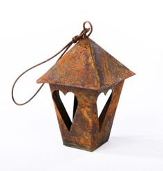 rusty tin lantern #fairygarden, imagine these hanging from your plants with some solar string lights inside....too cute!