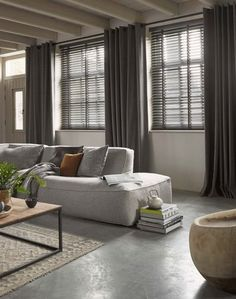 Venetian blinds and linen curtains