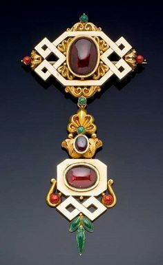 Brooch | Designer ?  Green and red enamel, garnets and sold.   c. 1830.  | The brooch originally belonged to Victoria, Duchess of Kent, who on her death in 1861 left her jewellery to her daughter, Queen Victoria. Queen Victoria subsequently gave the brooch to her third daughter Helena, Princess Christian of Schleswig-Holstein, as a present on her 24th birthday in 1870.