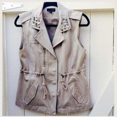 """SUPER SALEGorgeous cargo vest Trendy tan color cargo vest with drawstring! Embellished collar. Snap and zipper closure. Perfect to dress up and style that chic outfit.  Vertical 4"""" faux zipper on right side and two usable side flap pockets! Worn only a couple of times! ✨Excellent condition✨, no stains, no rips!  Like new✨Professionally dry-clean and ready for a new home!  loveposh Jackets & Coats Vests"""