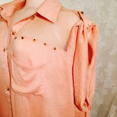 Amazing salmon color blouse with gold studs. Amazing salmon color blouse with gold studs. 65% Rayon 35% Polyester. This material gives you a comfortable feeling. I believe you will love it very much. Lots of details hard to see in pictures. Bottons down blouse Check it out Plus Tops Blouses