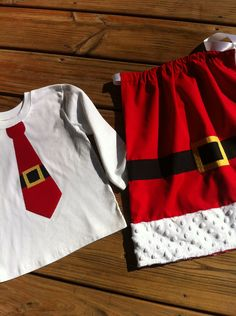 Custom boutique children's clothing. Christmas sibling set. Red Mrs Claus pillowcase dress & Santa Claus tie shirt.  By EverythingSorella. $55.00, via Etsy.