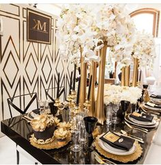 Black Gold and White - so glamorous! Love the white orchids and these beautiful…