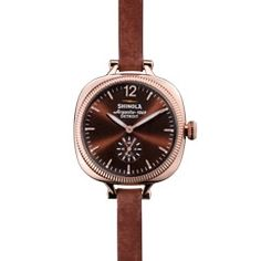 The Gomelsky 36mm orchid leather watch with brown face is an American-made timepiece that features a wide-eyed case, coin-edge bezel and a Swiss quality quartz Argonite 1069 movement, which is assembled in Detroit from nearly four-dozen Swiss made parts.