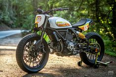The ultimate sleeper bike: a very discreetly upgraded 2016 Ducati Scrambler. Smart work from Tom Zipprian, a mechanical engineer at Zero Motorcycles. Womens Motorcycle Helmets, Motorcycle Design, Motorcycle Girls, Honda Motorcycles, Vintage Motorcycles, Ducati Scrambler Custom, Scrambler Motorcycle, Ducati Monster 1100 Evo, Motorcycle Manufacturers