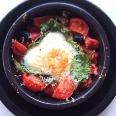 Baked eggs with spinach, tomatoes and olives