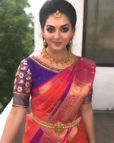 In a Kanchipuram / pattu pink &and violet color saree, boat sleeve blouse design. - In a Kanchipuram / pattu pink &and violet color saree, boat sleeve blouse design, necklace, head pi - Wedding Saree Blouse Designs, Half Saree Designs, Pattu Saree Blouse Designs, Blouse Designs Silk, Wedding Sarees, Lehenga Saree Design, Blouse Patterns, Vintage Louis Vuitton, Bridal Silk Saree