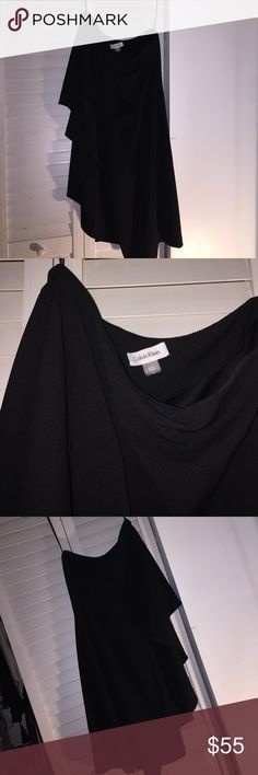 Calvin Klein black beautiful dress Used once. Size  4.  Plain black. Sleeveless on one side the other side has a flowy type of sleeve. Really simple and delicate dress. Calvin Klein Dresses Midi