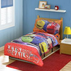 """Chuggington - """"Ride the Rails"""" 4-Piece Toddler Bedding Set:  This 4-piece bedding set is designed to fit a standard toddler-size mattress and features the saying """"Let's ride the rails"""" that is so popular with kids who watch the show. Easy to care for because it's machine washable. Sure to make a train-tastic night's sleep!"""