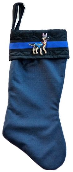 Add a personal touch to your holiday morning with this unique and beautifully decorated handmade stocking! Made with Ripstop Navy Blue Material and Black Quilting,accented with a cool patch, looks great for Christmas.