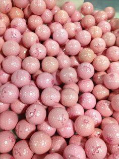 Dozens of pink golf balls.