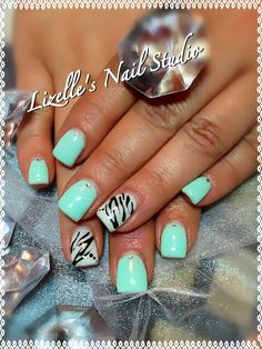 Mint gel colour with pearl white zebra accent nails with small silver gems on each nail. Hand-painted nail art.