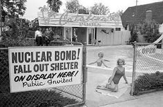 A Catalina Pools installer-dealer in the San Fernando Valley advertises its additional nuclear fallout shelter business (ca. Note the thematic juxtaposition of suburban backyard living, attractive models in bathing suits, palm trees, and nuclear combat. Herbert List, Nuclear Bomb, Nuclear War, Nuclear Fallout Shelter, Bomba Nuclear, Arizona, Bomb Shelter, E Mc2, Tropical