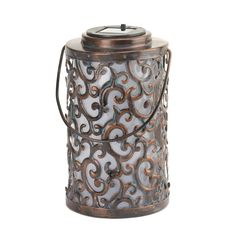 """The gorgeous iron swirls and flourishes make this solar-powered lantern a beautiful accent for any outdoor space. The built-in solar panel at top will soak in the sun's rays all day long, and by night the interior will glow with magical light. Weight 0.80 lb. 5.00"""" x 5.00"""" x 8.25"""". Iron, Solar Panel, Plastic. UPC Number: 849179020002. Solar Garden Lanterns, Solar Powered Lanterns, Solar Lights, Camping Lanterns, Lantern Candle Holders, Candle Lanterns, Cheap Lanterns, Wedding Lanterns, Candleholders"""