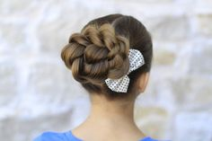 Rope Twisted Bun..love this for prom or a wedding.  Or even dance! #hairstyles #hairstyle #bun #twist #cutegirlshairstyles #CGHropetwistbun #updo #athleticstyle #prom