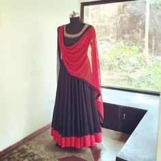 Fabric - ModalThis ensemble for the gypsy in you. Deep black feminine flow and red striking through it. Beautiful hand embroidery.