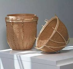 """43mh   FROM THE POND  Marion Hildebrandtwaxed linen twine warp, paper twine weft, hand twined cattail leaves  8.75"""" x 8"""" x 8"""", 2002    44mh   FINLANDIA  Marion Hildebrandtwaxed linen twine warp, paper twine weft, california hazelnut branches  5.5"""" x 8.5"""" x 8.5"""", 2002"""