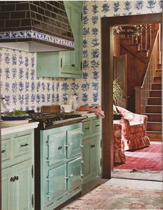 "Delft blue tiles & Benjamin Moore ""Everglades"" on the cabinets"