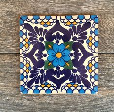 This is a beautiful hand painted Mexican tile that has lovingly been turned into a trivet for all your hot or cold dishes. It comes in a gorgeous blue floral pattern and has four felt pads on the bottom to protect your tabletop or other surfaces. It measures 6 x 6 and is roughly 0.5 tall.
