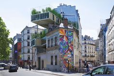 """""""Parasitic"""" Apartments Are Taking Over Paris - unusual ways to bring low-cost housing into dense cities. involves new constructions that pop up on, lean on, or extend from existing structures - """"parasitic architecture."""" Near the city's Canal Saint-Martin, steel wood n glass boxes by 3BOX project"""
