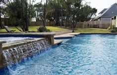 Beautiful geometric pool with a spa built in the beautiful hill country in Austin, Texas.  The sound of water is always a good thing.  #masterpoolsofaustin #masterpoolsguild