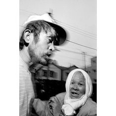 Homeless couple wander the streets Tokyo 1996 by bruce_gilden