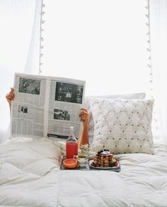 Reading the newspaper in bed with a breakfast trayt - http://www.homedecoratings.net/reading-the-newspaper-in-bed-with-a-breakfast-trayt
