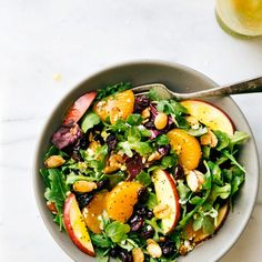 Mandarin oranges, apples, cranberries, feta cheese, and easy stovetop candied almonds mixed greens salad with an orange poppyseed dressing