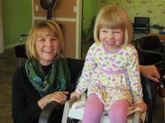 Sarah getting a haircut with Nana( grandma)