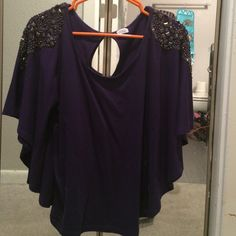 Purple shirt with gems This shirt is purple with gold and silver gems on the shoulders. Size small Loose fitting Charming Charlie Tops