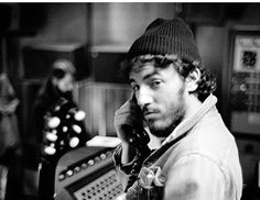 Bruce Springsteen takes a phone call during the BTR sessions, 1974-75.