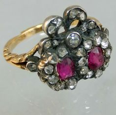 Double heart gold and silver ring set with diamonds and rubies . Probably rather European than English, ca 1800