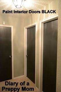 Diary of a Preppy Mom: Paint It: Interior Doors go BLACK.  Looks so nice, house has similar crown molding, wouldn't be too bad.