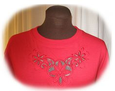 This t-shirt was decorated with a cutwork design. I used an original Husqvarna Viking design, the cutwork needles and mye Designer Diamond.