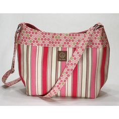 The Jensen Cross Body Bag in Pink Tan and Brown Polka Dot and Stripes ($49) ❤ liked on Polyvore