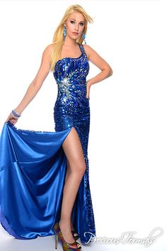 Precious Formals Style P55238 Shimmery royal sequins completely cover the skirt of this dress, and are paired with large gems to accent the bodice.