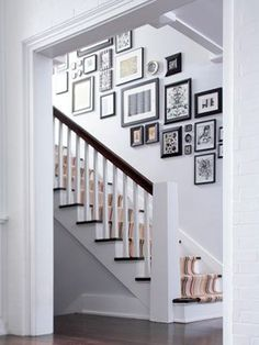 Hallway Decorating Ideas With White Wall Color And Staircase With Wall Mounted Picture Framed Also Dark Grey Laminte Flooring Color Home Design, Decoration, Interior Design Excellent Narrow Hallway Decorating Ideas Design Hallway Decorating, Entryway Decor, Decorating Ideas, Decor Ideas, Stair Decor, Picture Arrangements, Photo Arrangement, Photo Grouping, Hanging Pictures